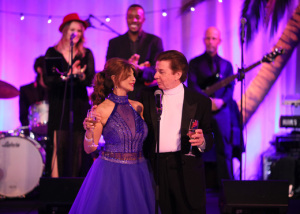 Brigitte and Bobby Sherman toasting their guests. Photo by Jason Kempin.