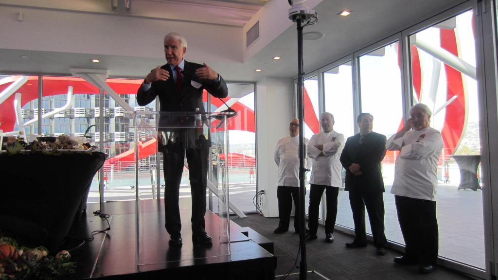 Architect Gene Kohn addressing the crowd, with the Dragos behind him. Photo by Celia Yusem.