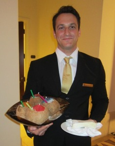 One of the lovely servers with the creative pina coladas.   Photo by Alice Farinas.