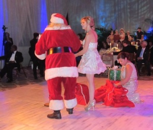Santa and his helpers handing out gifts--to EVERYONE IN ATTENDANCE!!!  Photo by Karen Salkin.