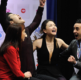 brother-and sister team of Maia and Alex Shibutani, flanked by their ecstatic coaches.