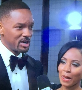 Doesn't Jada Pinkett look bored while hubby Will Smith is speaking seriously?  She looked even more so in action. Photo by Karen Salkin.