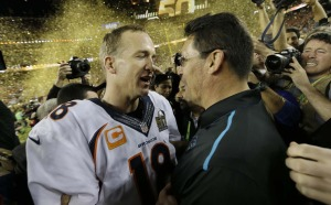 Peyton Manning being congratulated on the win by good sport Carolina Panthers' head coach Ron Rivera.