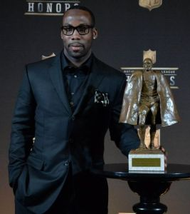 Anquan Boldin, with his Walter Payton Man of the Year trophy.