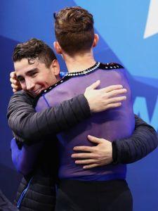 Max Aaron congratulating teammate Adam Rippon on a wonderful skate.