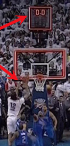 "The ball was clearly still in the hands of the Thunder player, in white, when the clock signalled the game was over.  But they thought he had beaten it, and celebrated prematurely.  How depressing for that team when it was ruled ""no basket."""