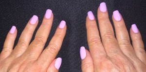 "Karen Salkin's new manicure, rocking LVX's polish in ""Fleur."" Photo by Alice Farinas."