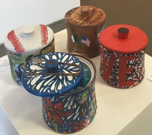 A few of the celeb-and-artist-designed ice buckets for auction. Photo by Karen Salkin.