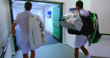 My favorite image of the tournament.  (That's why it's at the top of this page, as well.) Jo-Wilfried Tsonga, (on the right,) carrying the heavy bag of his injured opponent, Richard Gasquet, (on the left.)  I'm getting choked-up just looking at the picture.  Photo by Karen Salkin.