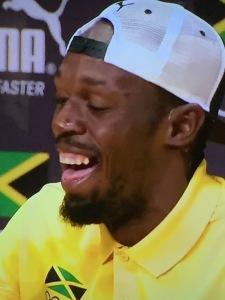 Usain Bolt.  (Wow--three bad teeth pix in a row!  So, see what I mean?!) Photo by Karen Salkin.