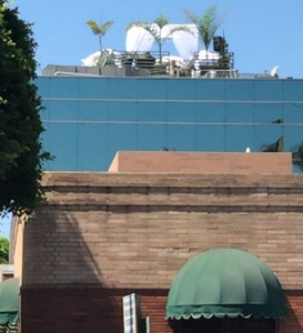 Looking up to Sonya Dakar's rooftop party from the street in Beverly Hills. Doesn't it look so inviting?   Photo by Karen Salkin.