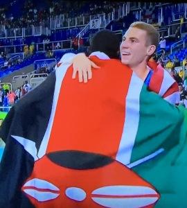 Bronze medalist Clayton Murphy, facing us, being embraced by winner David Rudisha. Photo by Karen Salkin.