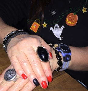 My Halloween nails. They are orange, not red, as they appear in this pic.  The high-class nail tech didn't want to make them cartoonish. And notice the shirt I'm wearing, in the background.  Goony enough for you?! Photo by Helen Rothwax.