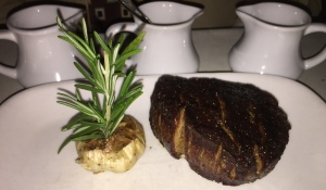 Filet Mignon, with the trio of sauces behind it. Photo by Karen Salkin.