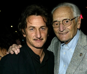 Chalres Aidikoff with Sean Penn, one of the many celebrities on his wall.
