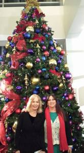 Jeanine Anderson and Karen Salkin in front of the gorgeous Christmas tree in the Ahmanson Theatre lobby.  Photo by a kind stranger.