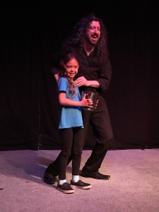 Andrew Goldenhersh with a special helper from the audience. Photo by Karen Salkin.