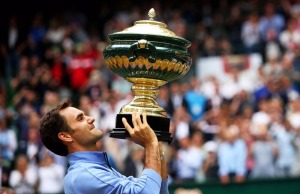 Roger Federer, hoisting his Championship trophy last week at Halle, a pre-Wimbledon grass tournament that he's won a record nine times!!!  OMG!