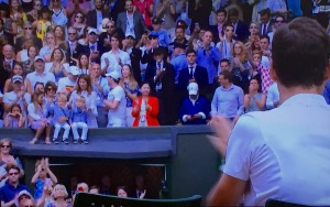 Roger, (whose back we see on the right,) waving to his family up in the stands, after he won.  I love this picture! Photo by Karen Salkin.