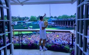 Victorious Roger Federer, greeting his throng of fans after his win at Wimbledon. Photo by Karen Salkin.