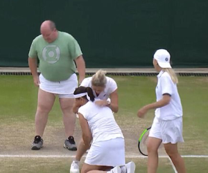 Adorable Kim Clijsters falling over her teammates with laughter, after putting her skirt on this male fan, so he could hit with them.