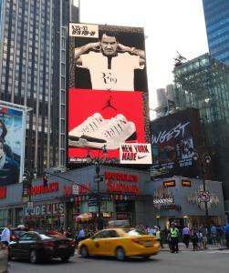 Roger Federer's impressive  image high above Times Square.