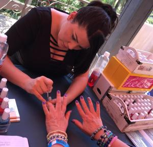 Alvina working on Karen Salkin's nails. Love that color! Photo by Lisa Politz.