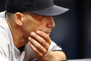 Joe Girardi, looking lile he might have known what was coming in this pic.  But look at his gorgeous hands!!!