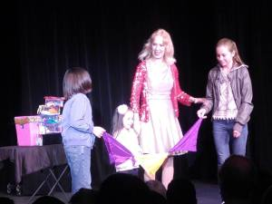Jeanine Anderson with a trio of kid assistants in a previous show.