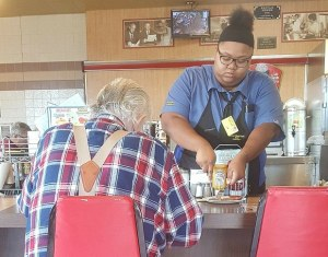 This is the waitress being kind, which looks like it's normal to her, so she rocks!