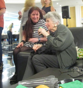 Karen Salkin (who's a tad blurry because she's in motion) and Marcia Nasitir, sharing a giggle.  Photo by Flo Selfman.