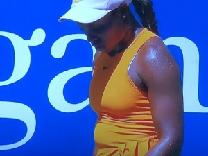 Sloane stephens, with one of the very many potbellies I noticed there.  Photo by Karen Salkin.