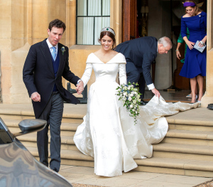 On their way as a married couple, with a little help from Prince Andrew and Princess Eugenie.  (I believe they were leaving their wedding breakfast here.)