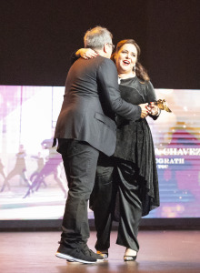A duo of fabulous choreographers, Kenny Ortega presenting a Choreo Award to Tessandra Chavez. Photo by Susy MIller.