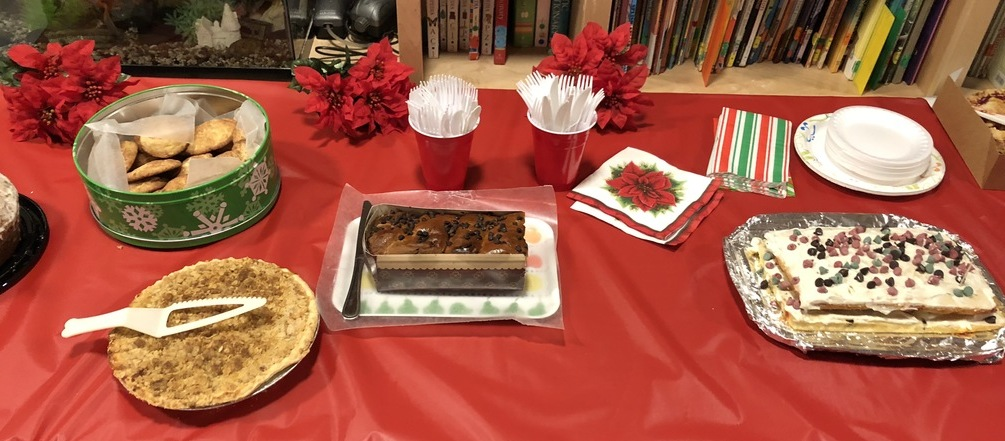 Part of the dessert buffet, with Karen Salkin's Chocolate Chip Christmas Cake on the right.  Photo by Karen Salkin, as is the big one at the top of this page.
