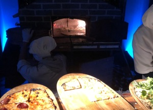 One of the pizza ovens with two chefs.  Photo by Karen Salkin.