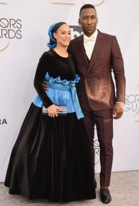 Mahershala Ali and his wife. Does she not have a mirror in her house???