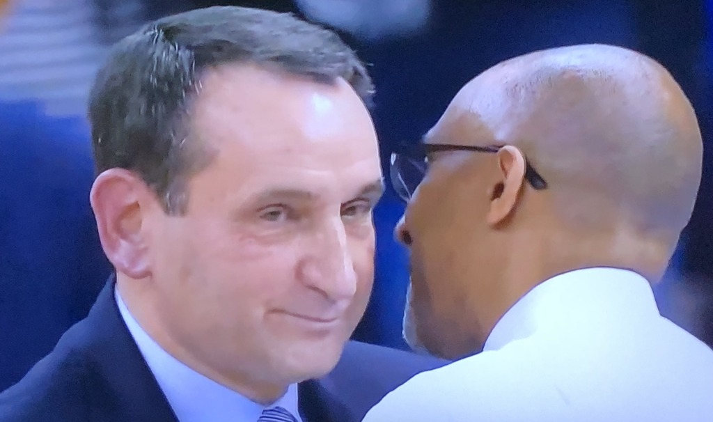 Duke's Coach K being congratulatied by opposing caoch, and very dear friend, Johnny Dawkins, right after the game.  Photo by Karen Salkin.
