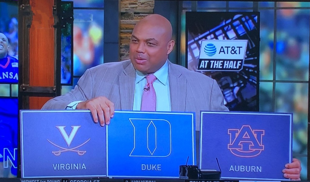 My favorite personality, Charles Barkley, holding signs for who he thinks will win this tourney.  It probably will be Duke, but he's sneaking his beloved Auburn in there!  Photo by Karen Salkin.