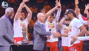 (L-R) Bill Russell, NBA Commissioner Adam Silver, and Finals MVP Kawhi Leonard, as he about to receive his trophy.