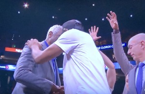 ...compared with Kawhi Leonard receiving the trophy this year, and hugging Bill Russell, for whom it is named!  (Note Kawhi's gigantic hands!!!) Photo by Karen Salkin.