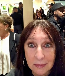 This is the closest Karen could come to a picture of herself with Ron Artest. She's in the foreground, (duh,) and Ron is the very tall drink of water by the pole behind her!  So they technically are in a picture together! Photo by Karen Salkin.