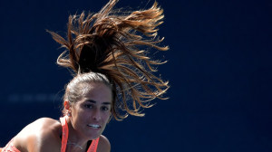 This is really just a tennis player captured in motion, but it looks like the selfish hair-dos that I usually wind-up sitting behind at the theatre!