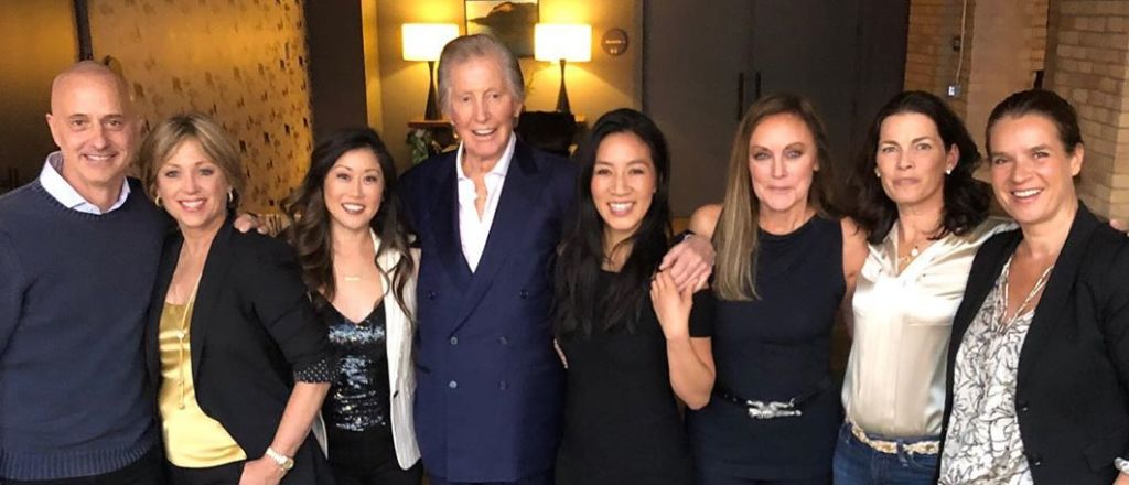 "Tom Collins with members of his skating ""family.""  (L-R) Brian Boitano, Dorothy Hamill, Kristi Yamaguchi, Tom, Michelle Kwan, Peggy Fleming, Nancy Kerrigan, Katerina Witt.  It's  so approrpiate that Tom is the one with the light around him!"