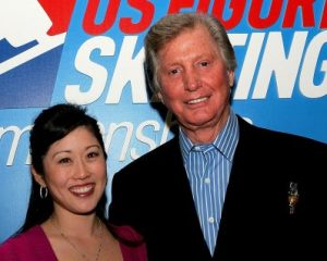 Tom Collins with Michelle Kwan.