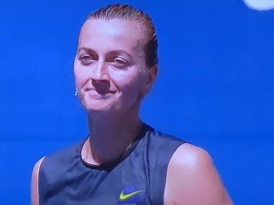 The always-lovely Petra Kvitova.  You can not tell if she won or lost as she walks to greet her opponent at the net, post-match.  (She had just lost, by the way.)  Photo by Karen Salkin.