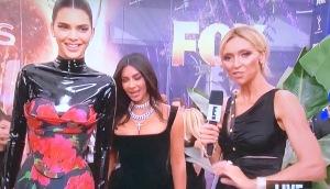A trio of weirdos: Kendell Jenner, Kim Kardashian, and Giant Forehead Woman!   Photo by Karen Salkin.