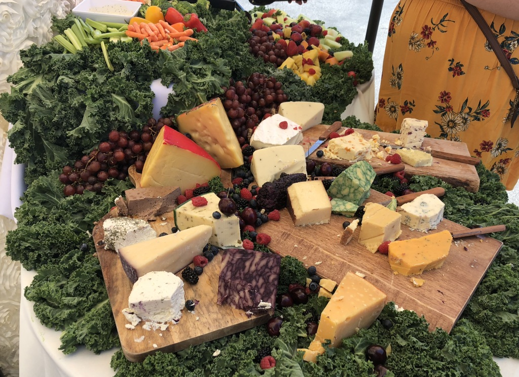 Just one of the tables of beautiful food at the summer 2019 Festival.  Photo by Karen Salkin.