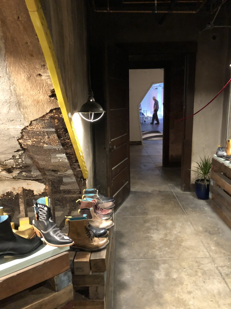 The secret entrance through the shoe store to the event space, which that distant man is standing in. Photo by Karen Salkin.