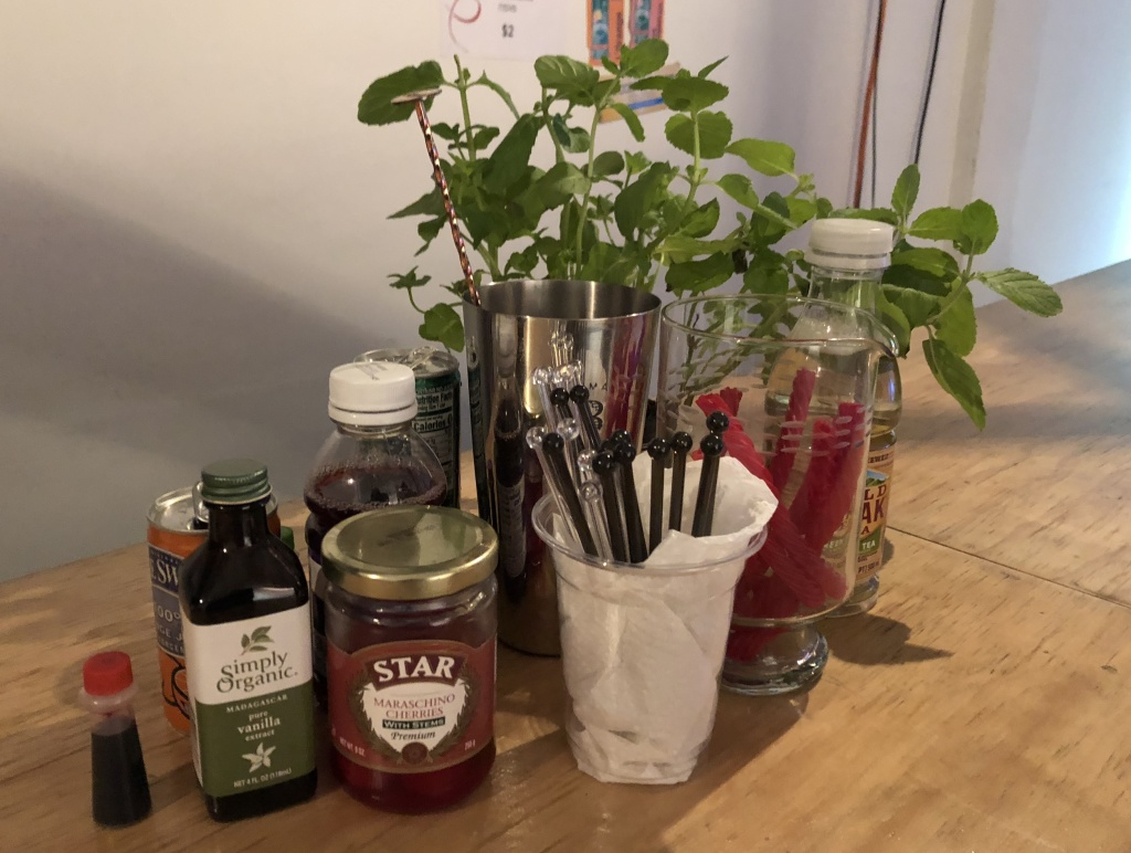 Part of the bar accoutrements, including a mint plant and Red Vines. Photo by Karen Salkin; composition by Nathan Pata.